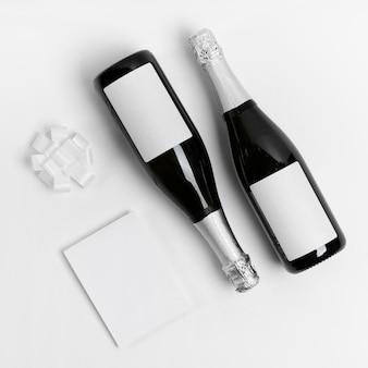 Botellas de champán laicas planas con lazo