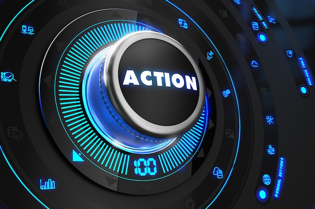 Botón de acción con luces azules brillantes en la consola negra