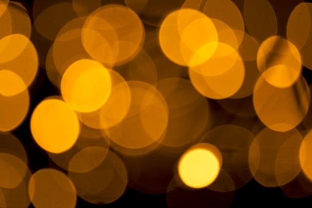 Brillantes luces de desenfoque sobre fondo abstracto