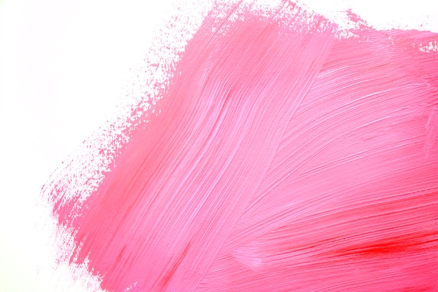 Brillantes trazos de color rosa en la pared