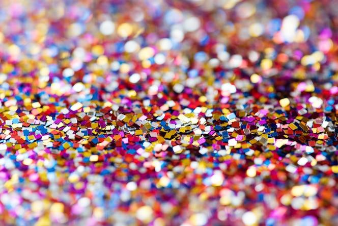 Brillo de colores con textura de fondo abstracto