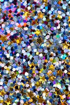 Brillo de lentejuelas colorido con textura de fondo abstracto