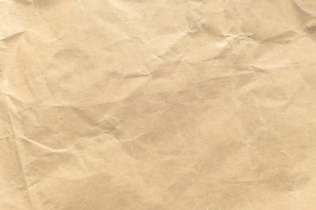 Brown arrugó el fondo de papel de la textura.