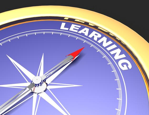 Brújula abstracta con aguja apuntando hacia el concepto de aprendizaje de la palabra aprendizaje.