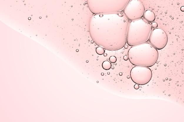 Burbuja de aceite de fondo abstracto rosa en papel tapiz de agua