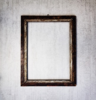 Se burlan de marco de madera vieja sobre un fondo gris grunge. imagen teñida