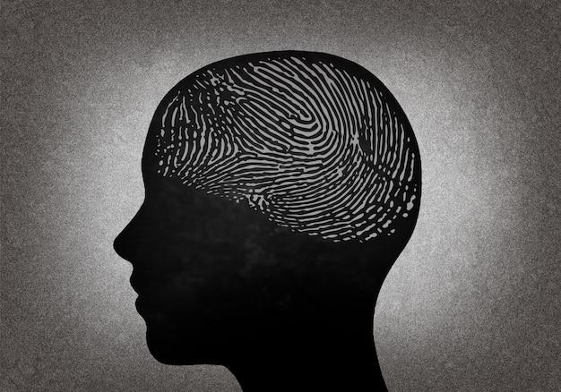 Cabeza humana con huella dactilar en el cerebro.