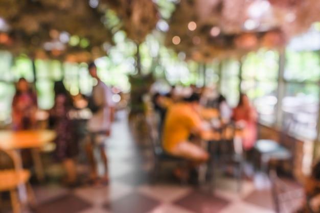 Cafetería nautre verde borrosa o restaurante cafetería