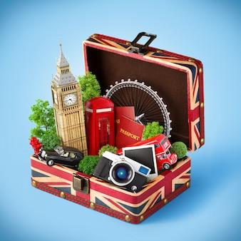 Caja abierta con bandera británica y monumentos famosos de londres en el interior