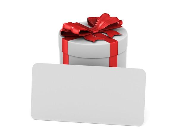 Caja blanca con lazo rojo y etiqueta sobre blanco