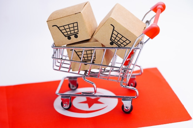 Caja con logo de carrito de compras en la bandera de túnez.