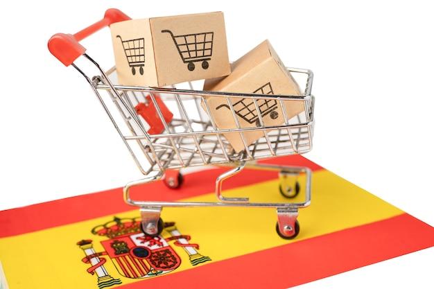 Caja con logo de carro de compras y bandera de españa.