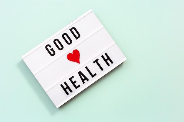 Caja de luz con palabras buen cuidado de la salud de la salud y el concepto médico. día mundial de la salud.