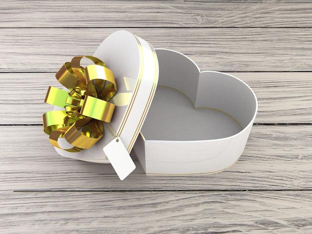 Caja de regalo abierta en forma de corazón sobre mesa de madera
