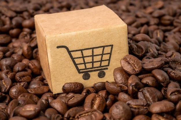Caja con el símbolo del logotipo de carrito de compras en granos de café
