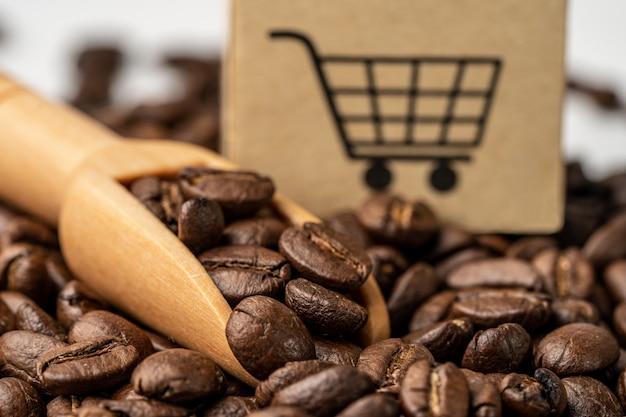 Caja con el símbolo del logotipo del carrito de compras en granos de café,