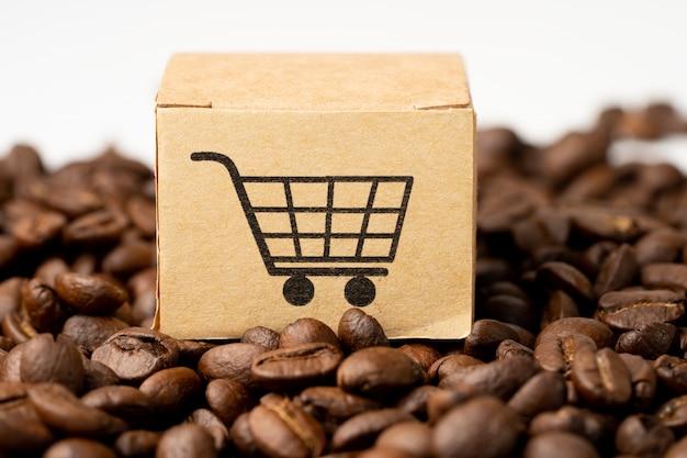 Caja con el símbolo del logotipo de carrito de compras en granos de café.