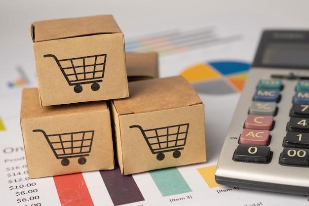 Cajas con el logotipo del carrito de compras en el fondo del gráfico