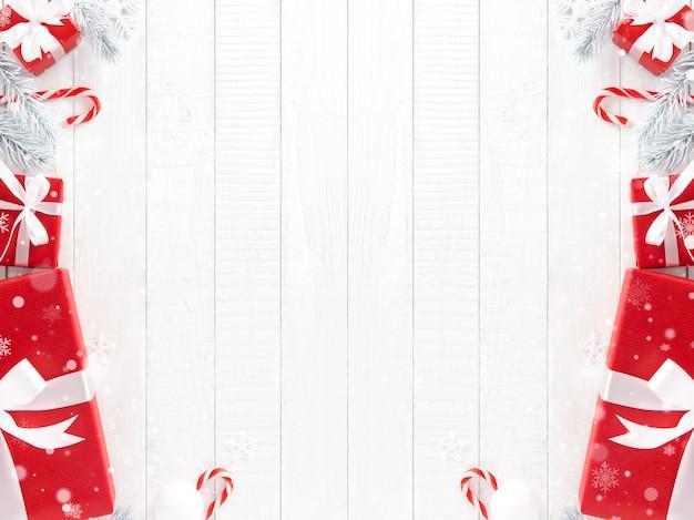 Cajas de regalo de navidad rojas con artículos de decoración sobre fondo de panel de madera blanco
