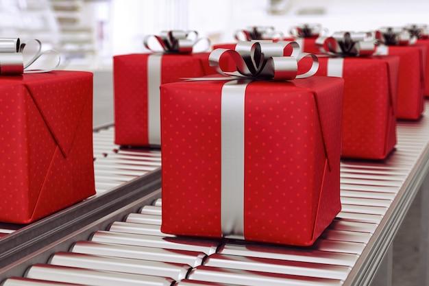 Cajas de regalo de navidad sobre rodillos transportadores listos para ser enviados por mensajería para su distribución