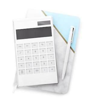 Calculadora moderna, lápiz y cuaderno sobre superficie blanca
