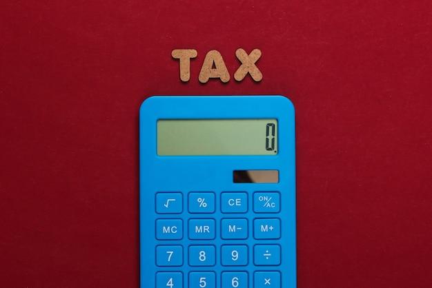 Calculadora con la palabra impuestos en rojo