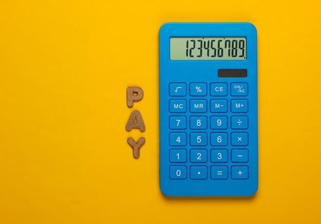Calculadora con la palabra pagar en amarillo