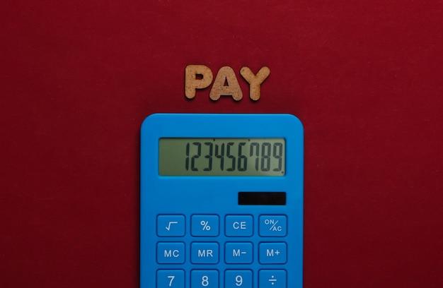 Calculadora con la palabra pagar en rojo