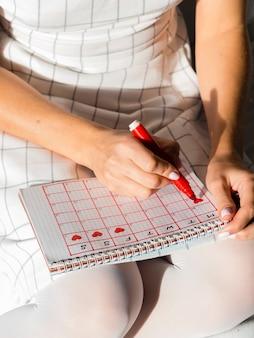 Calendario de alta vista con período de menstruación
