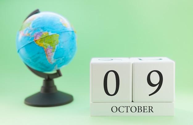Calendario de madera con 09 días del mes de octubre