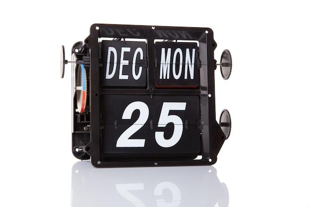 El calendario mecánico retro fecha 25 de diciembre, aislado navidad.