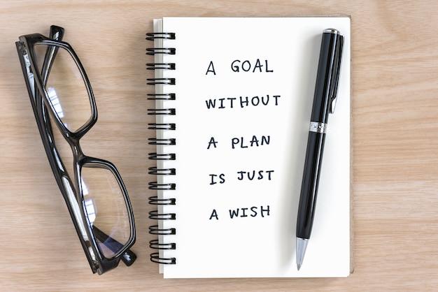Caligrafía motivacional en un cuaderno