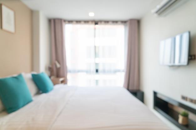 Cama de desenfoque abstracto en el dormitorio para el fondo