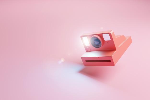 Cámara de fotos instantánea retro roja disparando el flash sobre una superficie rosa