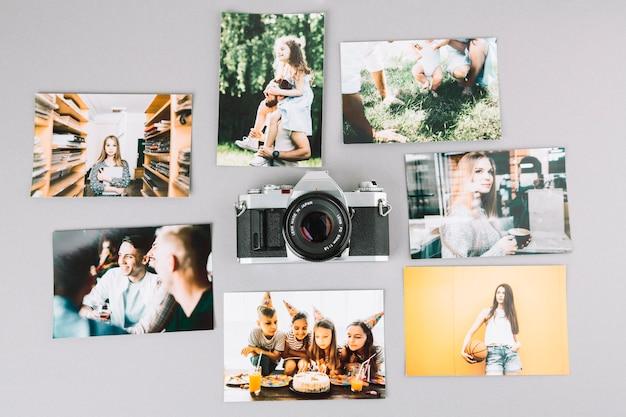 Cámara profesional rodeada de fotos