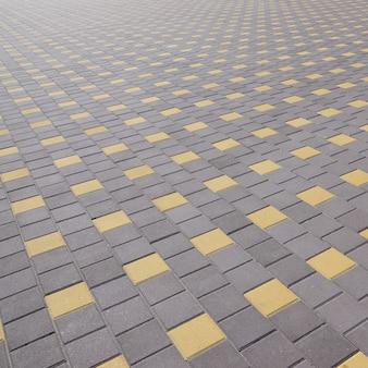 El camino de adoquines en la plaza del pueblo. textura en perspectiva