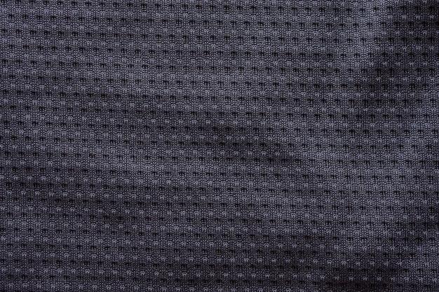 Camiseta de fútbol de ropa deportiva de tela negra con fondo de textura de malla de aire