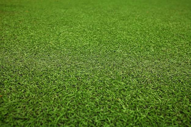 Campo de fútbol de césped artificial verde. el fondo verde