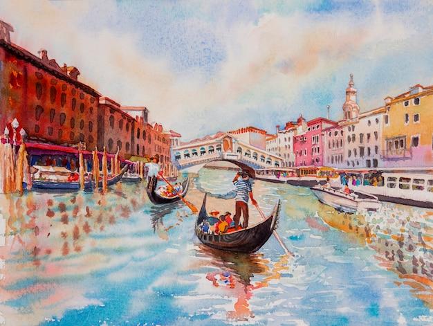 Canal de venecia con turista en góndola