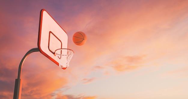 Canasta de baloncesto sobre una cálida puesta de sol con nubes y la pelota cayendo en el aro. representación 3d