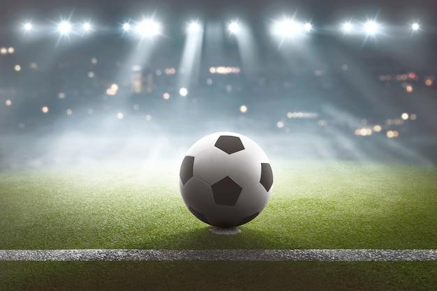 Cancha de futbol con pelota en el estadio y luces.