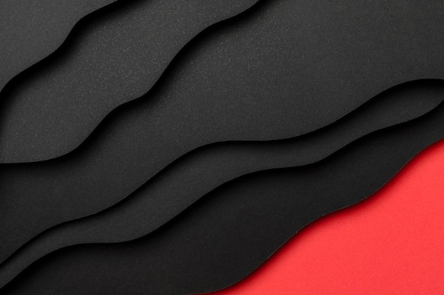 Capas de papel negro y fondo rojo.