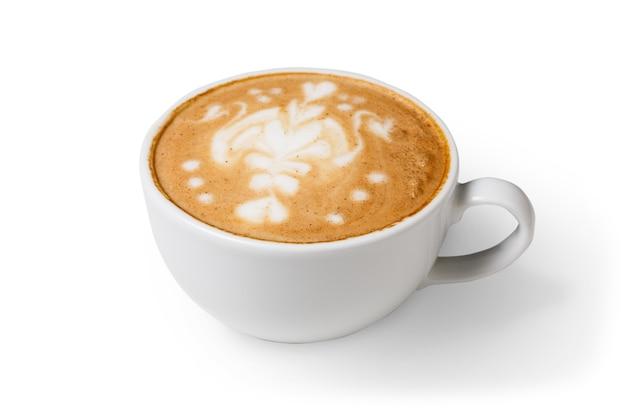 Capuchino con espuma espumosa, primer plano de la taza de café aislado. café y bar, concepto de arte barista.