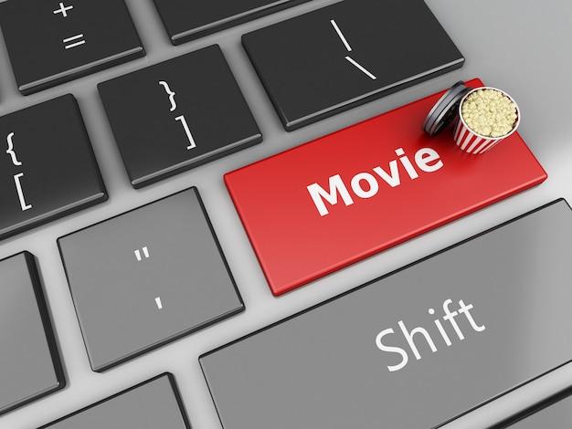 Carrete de palomitas y película 3d en el teclado de la computadora.