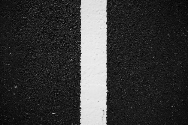 Carretera de asfalto marcando la carretera textura de fondo línea blanca