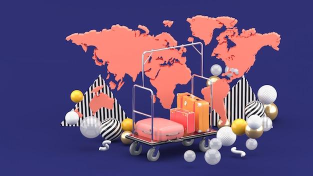 Carretilla de botones entre el mapa mundial y bolas de colores en el púrpura. representación 3d