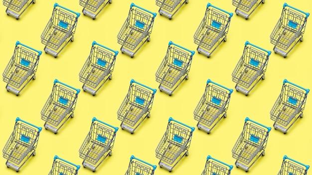 Carro de la compra de metal (juguete), clonado, propagado sobre fondo amarillo. patrón de fondo.