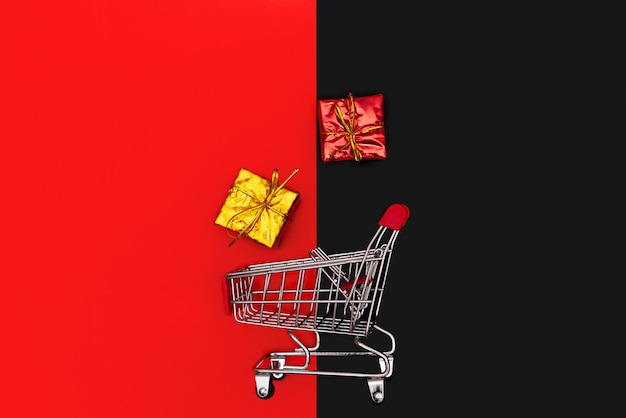 Carro de compras y caja de regalo, venta al final del año y 11.11 concepto de venta de día de solteros