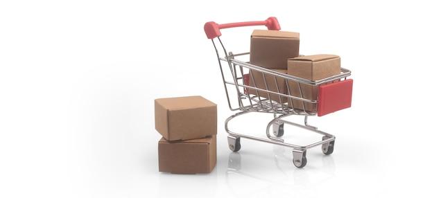 Carro de compras de juguete con concepto de compras y entrega de cajas. tendencia de la sociedad de consumo