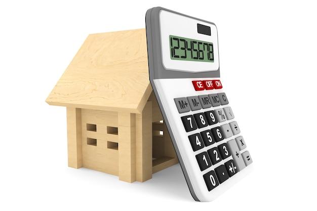 Casa de madera con calculatoron un fondo blanco.